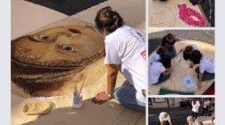 Maestri infioratori di Genzano all'opera per regalare alla comunità e ai visitatori il magico spettacolo dell'Infiorata di Pane